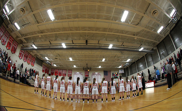Topsfield. The Masco girl's basketball team lines up for the National Anthem prior to the start of the Chieftans game against Cambridge on Wednesday evening. David Le/Salem News