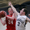 Hamilton: Masco junior Kevin Martin, left, grabs a rebound while being fouled by Hamilton-Wenham senior Nick Fusco, right, on Tuesday evening. David Le/Salem News