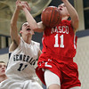 Hamilton: Masco senior captain Tighe VanLenten, right, loses the ball after being fouled by Hamilton-Wenham junior Henry Eagar, left, on VanLenten's way to the rim. David Le/Salem News