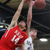 Hamilton: Masco junior Alberto Arenaza, left, and Hamilton-Wenham sophomore Shawn Kotch, right, battle for a rebound during the second quarter of play on Tuesday evening. David Le/Salem News