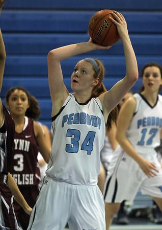 Peabody: Peabody High School junior Carolyn Scacchi takes a jump shot against Lynn English on Tuesday evening. David Le/Salem News