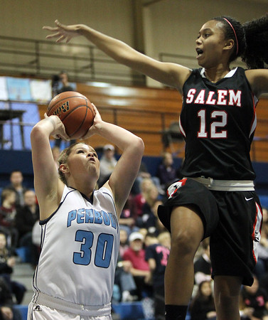 Peabody: Peabody junior forward Olivia Summit, left, takes a jump shot while Salem freshman Maritza Scott, leaps high in the air as she attempts to block the shot. David Le/Salem News