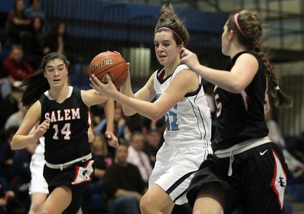 Peabody: Peabody sophomore forward Courtney Bua, center, splits Salem's Rachael Zipper, left, and Arianna Gaffney, right, and drives hard to the hoop. David Le/Salem News