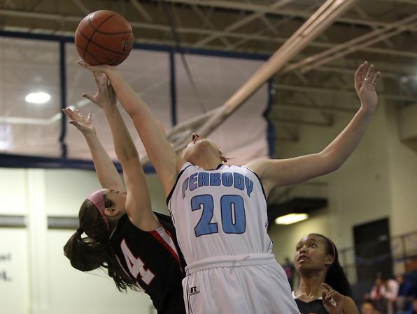 Peabody: Peabody junior forward Amanda Matthews, right, hangs in the air and grabs a rebound over Salem sophomore Rachael Zipper, left, on Friday evening. David Le/Salem News
