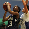 Hamilton: Pingree senior forward Mdolelle Dolo, left, shoots a layup against Notre Dame on Thursday evening. David Le/Salem News