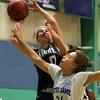 Hamilton: Pingree junior guard Haley Sabino, left, goes up hard to the hoop while getting fouled by Notre Dame's Marilyn Taveras, right, on Thursday evening. David Le/Salem News