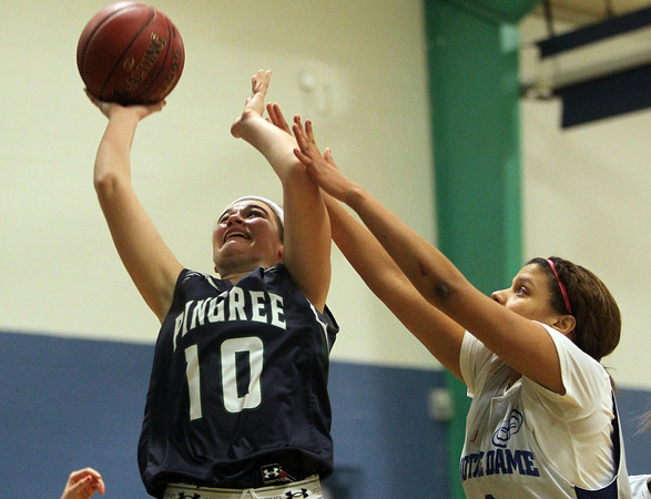 Hamilton: Pingree junior guard Haley Sabino gets fouled by Notre Dame's Yaniery Martinez, right, while going up for a layup. David Le/Salem News