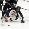 Salem: Salem State freshman Andrew Bettencourt loses his footing but keeps control of the puck with his stick against UMass Darmouth on Thursday evening. David Le/Salem News