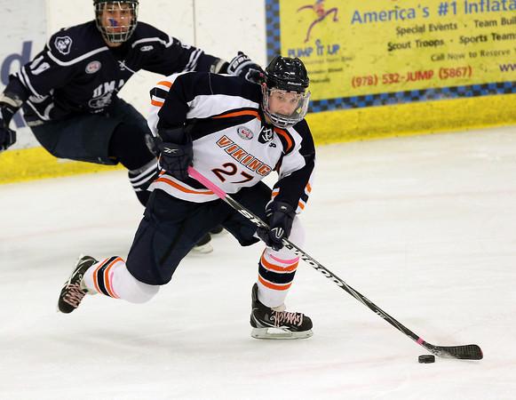 Salem: Salem State University freshman defenseman Stephen McManus carries the puck up-ice against UMass Dartmouth on Thursday evening. David Le/Salem News