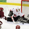 Salem: Salem High School junior goalie Brett Harring makes a great save on a breakaway attempt from Lowell's Tyler Ford, during the third period of play on Wednesday evening. David Le/Salem News