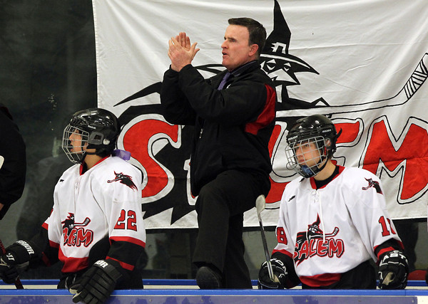 Salem: Salem High School Head Coach Ted Hanley claps on the bench following a good play by the Witches against Lowell on Wednesday evening. David Le/Salem News