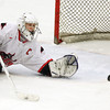 Salem: Salem junior goalie Brett Harring keeps his eyes on the puck as it trickled across the crease after making a save against Lowell on Wednesday evening. David Le/Salem News