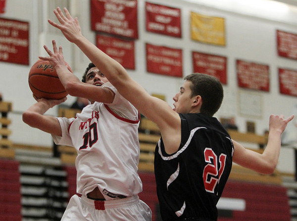 Salem: Salem junior guard Marvin Baez looks to get a shot off while being blanketed by Winchester's Jack Grassey. David Le/Salem News