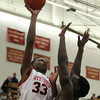 Salem: Salem High School junior forward David Kazadi elevates and shoots a hook shot over a Winchester player during the first half of play on Tuesday evening. David Le/Salem News