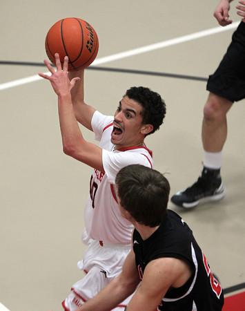 Salem: Salem junior Marvin Baez drives hard to the hoop against Winchester on Tuesday evening. David Le/Salem News