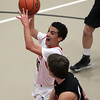 Salem: Salem junior Marvin Baez drives hard to the hoop against Winchester on Tuesday evening. David Le/Salem News