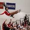 Salem: Salem High School sophomore Eliza Ramirez gets caught by her teammates after being thrown high in the air and performing a stunt during a time-out during Tuesday evening's basketball game. David Le/Salem News