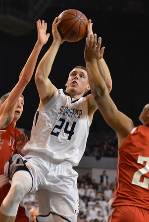 Worcester: St. John's Prep player Pat Connaughton eludes a Shrewsbury double team to make a shot. photo by Mark Teiwes / Salem News