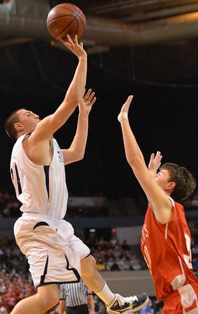 Worcester: St. John's Prep player Mike Carbone soars on a jump shot. photo by Mark Teiwes / Salem News