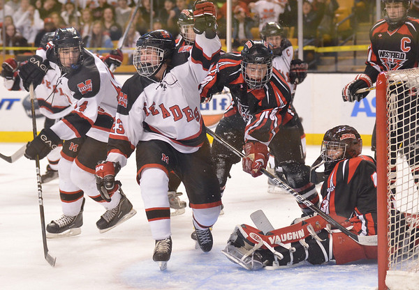 Boston: Marblehead's Austin Haley celebrates a first period goal against Westfield at the Division 3 state finals. photo by Mark Teiwes / Salem News