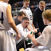 Worcester: St. John's Prep head coach Sean Connolly talks strategy with his team midway through the cahmpionship game. photo by Mark Teiwes / Salem News