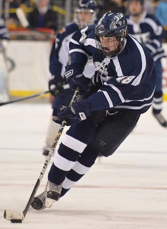 Boston: St. John's Prep forward Shane Eiserman flies up the ice at the TD Garden.   photo by Mark Teiwes / Salem News