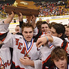 Boston: Marblehead's Ben Koopman, center, hoists the Division 3 state final trouphy. photo by Mark Teiwes / Salem News