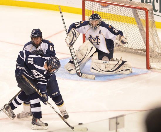 Boston: St. John's Prep forward Shane Eiserman, left, gets a look on the goal during the team's 4-3 overtime loss to Malden Catholic in the division 1A state finals.   photo by Mark Teiwes / Salem News