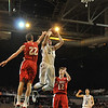 Worcester: St. John's Prep player Pat Connaughton pulls up for a jumper out of the reach of St. John's High School (Shrewsbury) player Ken Harrington. photo by Mark Teiwes / Salem News