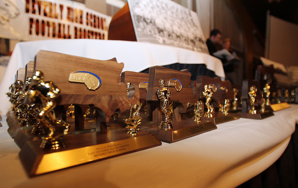 Danvers: Mini versions of the Beverly Panthers D2A Super Bowl Trophy were given out to each member of the 2012 varsity squad that went 13-0. David Le/The Salem News