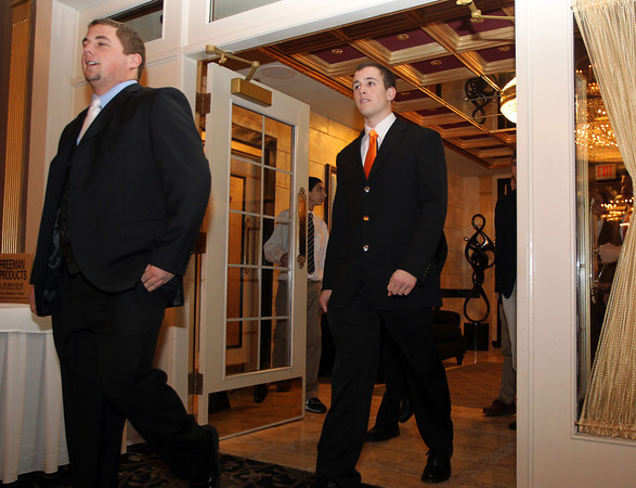 Danvers: Senior football captains Marc Babcock, left, and Dave Rollins, right, led the 13-0 Beverly Panthers into the Harborview Ballroom at the Danversport Yacht Club for their annual banquet on Thursday evening. David Le/The Salem News