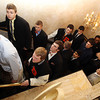 Danvers: The Beverly High School varsity football team lines the stairs inside the Danversport Yacht Club on Thursday evening as they prepare to march into their annual banquet. David Le/The Salem News