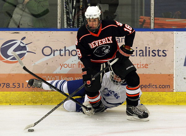 Salem: Beverly senior forward Nate McLaughlin manages to control the puck while evading a falling Danvers defender during the first period of play on Saturday afternoon. In a battle of the top two teams in the NEC Large, undefeated Beverly (7-0) stayed perfect on the season with a 3-0 win over Danvers (5-2-1) at Rockett Arena. David Le/Salem News
