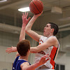 Beverly: Beverly junior forward Nick Cross, right, elevates and releases a hook shot over Danvers junior Kieran Beck, on Tuesday evening. David Le/Salem News