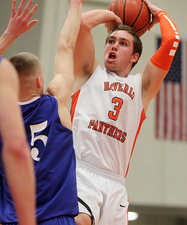 Beverly: Beverly senior forward Cam Rogers, right, takes a fadeaway jumper while being defended by Danvers senior Nick Bates, left, on Tuesday evening. David Le/Salem News