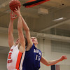 Beverly: Danvers senior Nick Bates, right, battles for a rebound with Beverly junior forward Zach Duguid, left, on Tuesday evening. David Le/Salem News