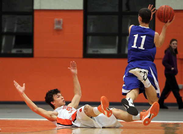 Beverly: Beverly junior forward Jonathan Berchoff, left, is called for a blocking foul on Danvers senior guard Eric Martin, right, during the second quarter of play on Tuesday evening. David Le/Salem News
