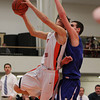 Beverly: Beverly junior forward Jonathan Berchoff, left, tries to get a shot off around the stifling defense of Danvers senior forward Dan Connors, right, during the first half of play on Tuesday evening. David Le/Salem News