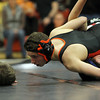 Beverly: Beverly High School junior Jonah Finegold, left, looks at the referee for a call while trying to pin down Danvers sophomore Zach Patt, right, in the 120 lb match on Wednesday. David Le/Salem News