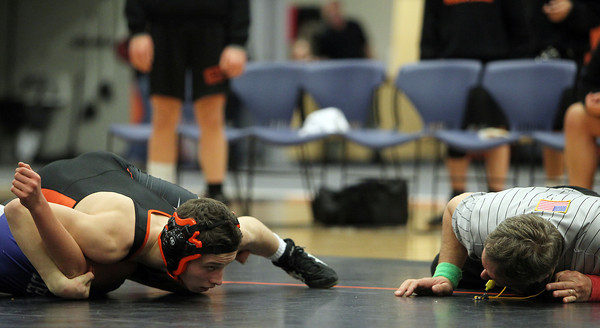 Beverly: Beverly High School junior Jonah Finegold, right, looks at the referee for a call while trying to pin down Danvers sophomore Zach Patt, left, in the 120 lb match on Wednesday. David Le/Salem News