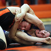 Beverly: Beverly's Brendan McGee, left, rolls out of a headlock from Danvers' Skylar Falite, right, in the 170 match on Wednesday evening. David Le/Salem News