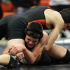 Beverly: Danvers freshman Kyle Warren, bottom, grapples with Beverly senior Antwan Tran during the 126lb match on Wednesday evening. David Le/Salem News