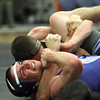 Beverly: Danvers 8th grader Jack Anderson tries to get out of a hold from Beverly junior Joey Kozlowski, on Wednesday evening. David Le/Salem News
