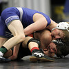 Beverly: Danvers sophomore Chris Davis, top, grapples with Beverly sophomore Mike Cirella, on Wednesday evening. David Le/Salem News