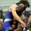 Beverly: Beverly's Terence Saye, right, picks up Danvers' John Papacostes as they wrestle in the 145 weight class match to determine the NEC title on Wednesday evening at Beverly High School. David Le/Salem News