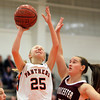 Beverly: Beverly High School freshman guard Melissa Lubas, left, goes up for a layup while being defended by Gloucester senior Kali Cook, right, during the third quarter of play on Friday evening. David Le/The Salem News