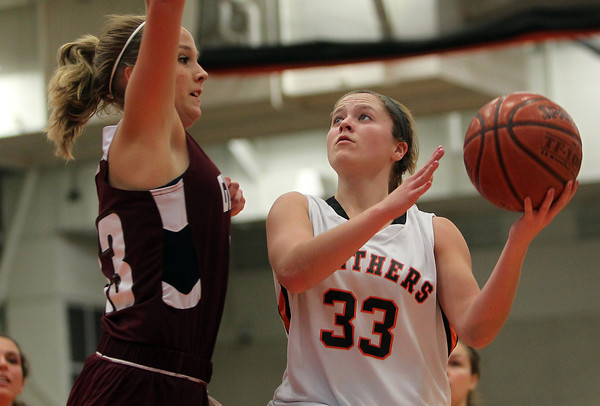 Beverly: Beverly junior guard Mary Cate Flaherty puts up a hook shot over Gloucester's Jessica Mathews, left, during the first half of play on Friday evening. David Le/The Salem News