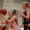 Beverly: Beverly senior captain Abby Carnevale looks to get a shot off while being defended by Gloucester's Marlee Melvin, right, on Friday evening. David Le/The Salem News
