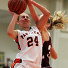 Beverly: Beverly junior Kate Silverstri gets her shot blocked by a Gloucester defender while driving to the basket on Friday evening. David Le/The Salem News
