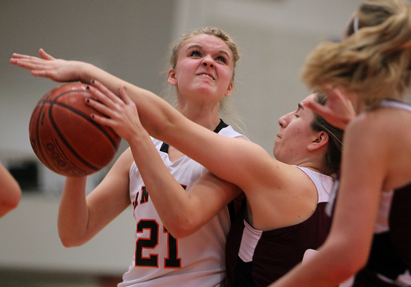 Beverly: Beverly High School junior Ashley Keaton gets fouled while driving to the hoop against Gloucester on Friday evening. David Le/The Salem News
